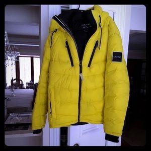 """""""CALVIN KLIEN"""" caneri yellow puffy coat."""